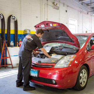 Auto Mechanic working on a vehicle in Arlington Heights, IL